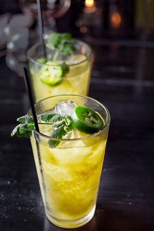 Cadejo Blanco ~ Anejo oro Rum, Plantaton Pineapple Rum, Bitter Liquor, Mango, Chimmichuri Greens, Lime (photo by Chamere Orr)